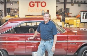 Phil Wheeler stands in his showroom in Bowling Green, Ky. Wheeler's garage at his home has become an attraction for car enthusiasts, which makes sense because he has about 40 cars in his showroom and about another 50 cars that he hasn't restored yet in another building. (Miranda Pederson/Daily News via AP)