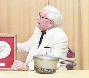 Col. Harland Sanders, founder of Kentucky Fried Chicken, is seen in this 1975 Richmond Register photo. A bronze statue of Sanders will be erected later this year.