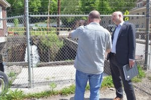 White House advisor Jason Walsh, right, visited Lynch on Tuesday as part of his information sharing tour about the POWER Initiative expected to be available.