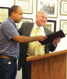 Two members of the Whitesburg City Council were presented with proclamations from the Kentucky General Assembly this week honoring them for their service in the military and their service to their community as council members. Above left, City Police Chief Tyrone Fields presents a framed proclamation to Larry Everidge. Above right, Mayor James Wiley Craft presents a similar framed award to Jimmy Bates. The councilmen served in Vietnam.