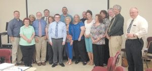 Letcher County Central High School senior Cameron Wright, who has served as student representative on the Letcher County Board of Education for two years, had his photograph taken with board members and central office staff during Monday night's meeting. Pictured from left is Kenny Cornett, district director of pupil personnel, Regina Brown, district director of special education, Twyla Messer, assistant superintendent, Will Smith, chairman of the board, Tony Sergent, superintendent, Erica Scott, board member, Cameron Wright, student representative, Brian Johnson, district finance officer, Lena Parsons, board member, Mendy Boggs, board member, Robert Kiser, board member, Debbie Cook, board secretary, Jackie Collins, district assessment coordinator, Denise Yonts, district director of curriculum and instruction, Darrell Hall, board attorney, Roger Martin, district director of state and federal programs and Bert Slone, school resource officer.
