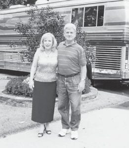 """Robert Hatton is pictured with singer Barbara Fairchild, whose best known song is """"Wish I Were a Teddy Bear"""". Behind them is the motor home in which she travels. She was visiting his neighbors, Goldie and Charlie Payne."""