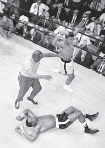 A young Cassius Clay danced around the ring after knocking out Sonny Liston in the first round of their May 1965 fight. (AP Photo)