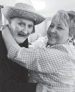 """Residents of Letcher Manor Nursing & Rehabilitation celebrated National Nursing Home Week recently with a """"Wild West"""". They enjoyed a bean can shootout with the Mountain Heritage Headstart, cowboy dress-up pictures, a cookout with the Letcher County senior citizens centers, and family night with the Pure & Simple Band. Pictured are Roland Holbrook and Activity Assistant Darlene Webb dancing the night away."""