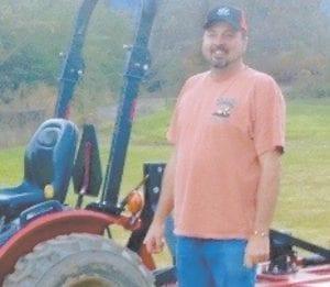 Chris Caudill loves farming at his home at Whitco, near Whitesburg.