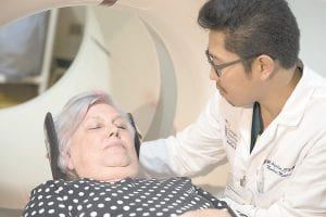 Judith Chase Gilbert, of Arlington, Va., is loaded into a PET scanner lby Nuclear Medicine Technologist J.R. Aguilar at Georgetown University Hospital. Gilbert shows no signs of memory problems but volunteered for a new kind of scan as part of a study peeking into healthy brains to check for clues about Alzheimer's disease. (AP Photo)