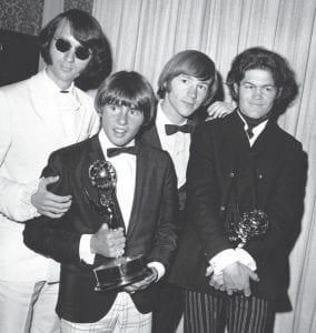 This June 4, 1967 photo shows The Monkees posing with their Emmy award at the 19th Annual Primetime Emmy Awards in California. The group members are, from left to right, Mike Nesmith, Davy Jones, Peter Tork, and Micky Dolenz. (AP Photo)