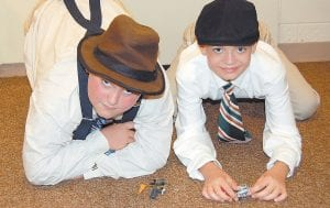 "— No, U.S. aviation pioneers Orville and Wilbur Wright didn't really visit West Whitesburg Elementary School last week to show two of the airplanes they invented. Actually, the ""Wright brothers"" pictured here are Landon Yeary (left) and Christian Hensley. The two are among the fifth grade students at West Whitesburg who researched the lives of famous people in history and portrayed these figures during a living history museum held May 29 in the school library. Students in the lower grade levels walked through the exhibit and asked the fifth-grade students who they were and what they did that was significant. Plenty more photographs of the event appear inside this issue. (Photo by Sally Barto)"
