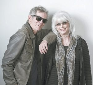 """Rodney Crowell, left, and Emmylou Harris pose for a portrait to promote their album """"The Traveling Kind."""" (Invision/AP)"""