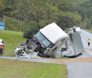 The tractor-trailer ended up on its side after a fatal accident that left KY 15 closed for several hours last Thursday.