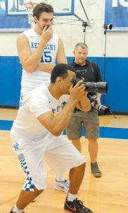Freshman guard Jamal Murray took a turn taking pictures during Kentucky's recent photo day as teammate Isaac Humphries watched. Murray says he can defend any position and also play wherever coach John Calipari needs him on offense. (Vicky Graff Photo)