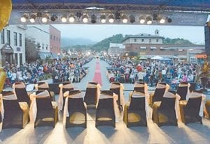 """A large crowd gathers on Wood Ave. in Big Stone Gap Saturday evening for a red carpet event honoring the stars of """"Big Stone Gap."""" (Photo by Ron Flanary)"""