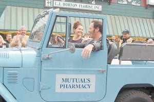 """Patrick Wilson, who spent summers as a child in southwest Virginia visiting his grandparents, smiles as he drives Ashley Judd through a parade celebrating the opening box office weekend of """"Big Stone Gap."""""""