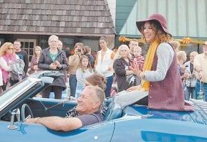 Big Stone Gap Mayor Leonard Rogers drives Erika Coleman down Wood Ave.