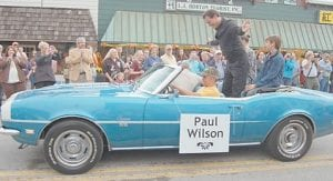 Paul Wilson bows to the crowd during the parade on Saturday morning.