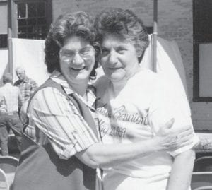 Sisters Dorthy Tacket and Pearl Noble are pictured at the last Marlowe reunion in front of the old company store which has since been torn down.