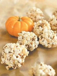 This photo shows marshmallow popcorn balls. You can go either sweet or savory when making popcorn treats. (AP Photo)