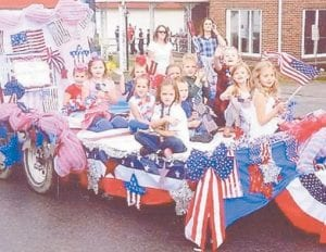 Member of the American Girls participated in the Mountain Heritage Parade on Sept. 28 and won second place. Pictured on their float are Macy Warf, Paige Caudill, Kirsten Caudill, Ava Thomas, Brooklyn Howard, Mia Bates, Anna Hatton, Anna Little, Josie Maggard, McKynlee Thomas and Raegan Turner. Not pictured are Aubrey Patterson and Emma Pavlik. Leaders are Tonya Little, Candi Caudill and Sue Webb. American Girls is the new name given to former Girl Scout Daisy and Brownie troops.