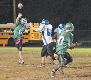 Jenkins quarterback Darian Slone heaved a short pass to teammate Audie Fields in the second half of Friday's 44-28 loss to Clinton County. Story appears on Page 2 of this edition. (Photo by Chris Anderson)