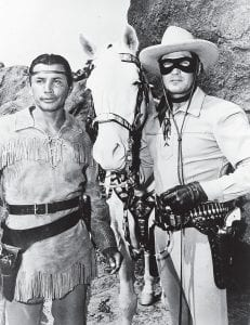 """Actors Jay Silverheels, left, as Tonto, and Clayton Moore in the title role of """"The Lone Ranger"""" are shown in a scene from the TV series in 1951. Moore delighted children of the 1950s with his hearty cry of """"Hi-Yo, Silver."""" (AP)"""