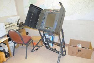 """LIGHT TURNOUT EXPECTED — A voting machine for Letcher County residents who can't make it to their voting precinct has been little used in the days leading up to next Tuesday's general election. While the races for governor and other statewide constitutional offices are on the ballot, a very low voter turnout is expected here, said Letcher County Clerk Winston Meade. Citing a lack of local races and voter apathy, Meade said, """"Most of your dedicated voters aren't here anymore and younger voters don't care."""" (Photo by Sally Barto)"""