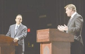 Kentucky Democratic gubernatorial candidate Jack Conway, right, responded to a question as Republican candidate Matt Bevin looked on during the League of Women Voters debate in Richmond earlier this week. (AP Photo/Timothy D. Easley)