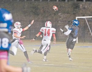 Letcher Central receiver Aaron Thomas, a senior, was open to haul in a long pass in Friday's 42-27 loss to visiting Whitley County. The Cougars will try to even their record when they play their final regular season game this Friday against visiting Union, Virginia. (Photo by Chris Anderson)