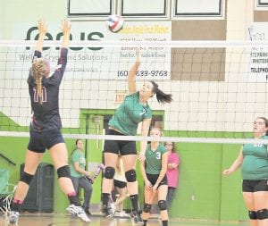 Jenkins High School's Lindsey Yonts spiked the ball across the net in the Lady Cavaliers' opening round 3 sets to 2 win in the 53rd District Volleyball Tournament. Jenkins finished second to Letcher Central. Both teams advanced to the 14th Region meet, where Jenkins was matched with Leslie County Tuesday night. If the Lady Cavs advanced they would meet the Wolfe Co. vs. Powell Co. winner at LCC Thursday.