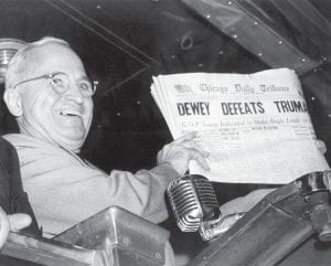 """U.S. President Harry S. Truman held an Election Day edition of the Chicago Daily Tribune, which, based on early results, mistakenly announced """"Dewey Defeats Truman"""" on November 4, 1948. The president told well-wishers at St. Louis' Union Station, """"That is one for the books!"""" (AP Photo/Byron Rollins)"""