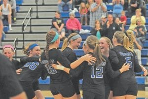 — Members of the Letcher County Central High School volleyball team celebrated after defeating Leslie County in the championship game of the 14th Region Volleyball Tournament at Ermine. The Lady Cougars now advance to the Girls' State Volleyball Tourney in Louisville, where they will meet 4th Region Champion South Warren. The match will take place at 5 p.m. Friday on the campus of Valley High School. (Photo by Chris Anderson)