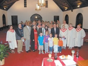 A special service commemorating 10 years of Reverend Jerry Utt serving Graham Memorial Presbyterian Church was held recently in the church sanctuary. Utt (center, wearing tie) posed with the adult members of the church and their children.