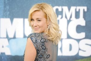 """Kellie Pickler is seen in this June 2015 photo arriving at the CMT Music Awards in Nashville. Pickler is a veteran of reality television after honing her musical and dancing skills on """"American Idol"""" and """"Dancing With the Stars,"""" so she was very careful about agreeing to a new CMT reality show about her marriage to songwriter and producer Kyle Jacobs. (AP Photo)"""