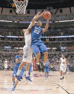 Kentucky guard Jamal Murray (23) shot over Duke guard Derryck Thornton during the second half of Tuesday night's game in Chicago. (AP Photo)