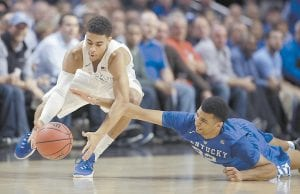Duke guard Derryck Thornton, left, grabbed a loose ball as Kentucky forward Alex Poythress fell to the floor during the first half of Kentucky's win over Duke Tuesday night in Chicago. UK will host Wright State on Friday. (AP Photo)