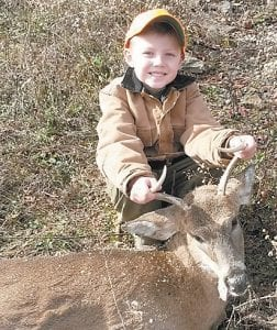 — Evan Adams, 5, shot his first deer this season, reports his father, Brian Yonts, who was along to help. Evan's mother Charlotte was also present when the deer was taken.