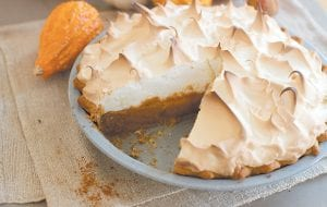 This Thanksgiving pie is deliciously deceptive, hidden under the meringue is a classic pumpkin pie spiked with just a hint of citrus. (AP Photo/Matthew Mead)