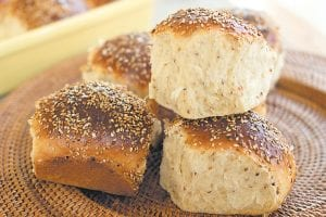 This recipe is a cross between an Italian scali bread, a light, tender bread crusted in sesame seeds, and a Portuguese sweet roll. (AP Photo/Matthew Mead)