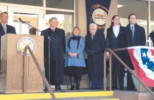 WRIGHT MOVES TO HIGH COURT — Kentucky Supreme Court Justice Samuel Tilden Wright III took the oath of office Monday in front of the Letcher County Courthouse. Among those taking part were (from left) former Supreme Court Justice Will T. Scott, Judge Wright, who is leaving the Letcher Circuit Court bench for the high court, his wife Jennifer Adams Wright, father S.T. Wright, and sons Samuel T. Wright IV and John Alexander Wright. Wright was sworn in by Supreme Court Chief Justice John D. Minton Jr. (Photo by Sally Barto)