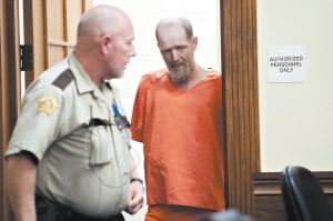 Murder suspect Timothy Madden appeared Monday for his arraignment in Allen County District Court in Scottsville, Ky. Madden, the former construction worker charged with kidnapping and killing a 7-year-old girl, pleaded not guilty Monday in a court hearing broken by the anguished sobs of the girl's mother. (Bac Totrong/Daily News via AP)