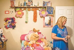 Amy Doolin, Gabriella's mother, stood in Gabriella Doolin's room at their home in Adolphus, Ky., after her disappearance. (AP Photo)