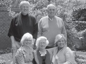 Dottie Combs surrounded by children (clockwise from top left) Dudley Webb of Lexington, Donald Webb (1939-2013), Judy Webb Lowry of Lexington, and Deborah Webb Howard of Harlan.