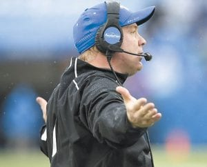 Kentucky head coach Mark Stoops gestured to his team during the second half against Louisville in Lexington. Louisville won the game 38-24. (AP Photo/David Stephenson)