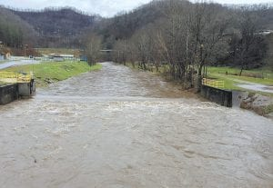 — Heavy rains on December 2 swelled the North Fork of the Kentucky River. At left is River Park, located below the Whitesburg hospital. In the center, is the low water dam located beside the Whitesburg Water Plant. (Photo by Diane Honchel)