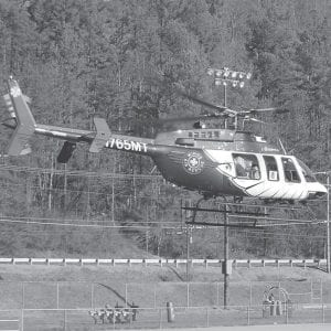 — Santa Claus waved to West Whitesburg Elementary students from a WINGS Air Rescue helicopter as he prepared to meet the students at the old Whitesburg High School football field on Tuesday. WINGS Air Rescue is based in Jenkins on the Gateway Industrial Site. (Photo by Sally Barto)