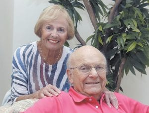 Aortic valve surgery patient Irwin Weiner poses for a photo with his partner, Lauree Gable, at their home in Boca Raton, Fla. Very old age is no longer an automatic barrier for aggressive therapies, from cancer care, to major heart procedures, joint replacements and even organ transplants. (AP Photo)