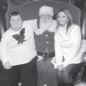 Enjoying the day with Santa Claus at a mall in Johnson City, Tenn., are Jonathan Sturgill and his sister, Lorie. They are the children of Ruby Sturgill of Craft's Colly.