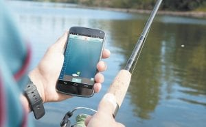 This photo provided by ReelSonar shows someone demonstrating the use of the iBobber. The iBobber fish finder attaches to your fishing line and floats on the surface of the water. Once you cast it, the iBobber can show you where fish are and how big they are. It also maps the floor of the waterbed, letting you know how deep the water is and pointing out obstacles, as far down as 135 feet, whether you fishing from shore, boat or dock. (Meagan West/ReelSonar via AP)