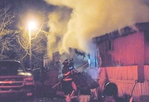 Neon Volunteer firefighters fought in vain to save this mobile home Monday night. The fire left Lori Watkins and her family of four homeless and without clothes. The fire department is accepting donations on behalf of the family. (Photo by Linda Collins)