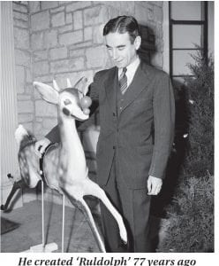 "Robert May, a Chicago advertising writer, places his hand on his creation, ""Rudolph the Red Nosed Reindeer,"" in front of his home in Skokie, Illinois in December 1949. May dreamed up ""Rudolph"" in 1939 at the request of his boss, Chicago-based Montgomery Ward. The firm used the character as part of its annual Christmas coloring book. As the story goes, Rudolph is being treated poorly by his fellow reindeer because of his bright red nose — that is, until Santa Claus asks him to lead his sleigh from the North Pole. Rudolph — who was almost called ""Rollo"" and ""Reginald"" by May — then becomes Santa's eighth reindeer and is treated with respect by all the others. (AP Photo/Ed Maloney)"