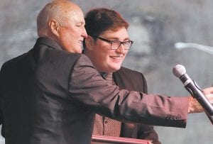 """State Senator Johnny Ray Turner, left, snapped a selfie with Jordan Smith, winner of NBC's """"The Voice"""" during a celebration honoring Smith on Monday in his hometown of Harlan. Turner was one of several state and local politicians who showed up for the event honoring the once-in-a-lifetime star. (AP Photo/James Crisp)"""